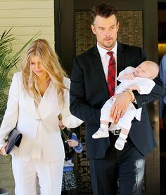 Fergie and Josh Duhamel baptize their son Axl.