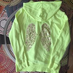 Victoria's Secret angels zip up hoodie Victoria's Secret angels zip up hoodie with angel wings sequins and gold perfect condition know where or tear.. Victoria's Secret Tops Sweatshirts & Hoodies