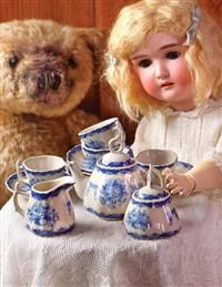 """Blue Roses Miniature Tea Set = High tea for the young at heart! An antiquarian delft pattern is rendered to a glazed porcelain tea set. -  Teapot (3.5""""), cream & sugar (3""""), 6 cups & saucers (3""""). Z"""