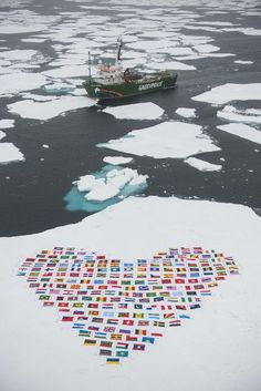 Flags Heart in the Melting Arctic  Photographer: Daniel Beltrá / Greenpeace