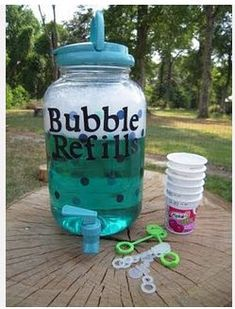 Bubbles - Items Used:  Refill container $6.00 at Wal-Mart  2 1/2  cups water and 1/2 cup light corn syrup  mix in a bowl together and microwave four minutes  Gently mix 1/2 cup dish liquid  (I was told Dawn is the best)  I made the letters myself with my Cricut and used Mod Podge to adhere them.