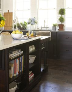 dark cabinets, marble counters, farmhouse sink