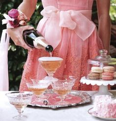 Pink champagne party with vintage glasses and stacked macarons