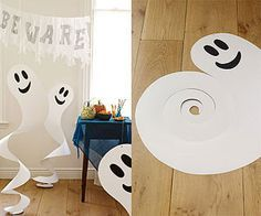 Hung from the ceiling, these friendly paper ghosts will swirl, sway, and spook all night long.  1. Draw a ghost shape on a sheet of white poster board, and cut it out. 2. Cut eyes and a mouth from black construction paper and attach them with glue. 3. To hang the ghost, poke a small hole in the top, thread a string through it, and knot it.