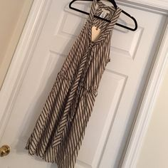 Tan and black dress Purchased from a boutique. Never worn. It has boutique tags still on it. Tan and black silky material. I need it out of my closet. It is missing the belt. Dresses