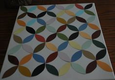 Paint-chip art project... I used paint chips (ever since Kevin was very little he always HAD to take a paint chip (or two) from the hardware store... he always forgot about them afterwards, but he still likes to take a chip each time we go... so I decided to make something with them instead of just letting them clutter up my craft bin!) I laid out my pattern on a canvas, and used mod podge to glue them into place... 2 additional coats to seal it all in and it's finished!