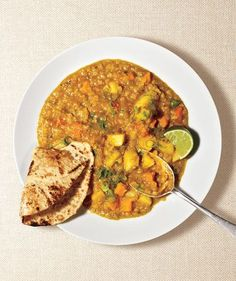 Red Lentil Curry | Yes, you can make Indian cuisine at home. Here, red lentils, carrots, and potatoes simmer with warm spices and vegetable broth until tender.