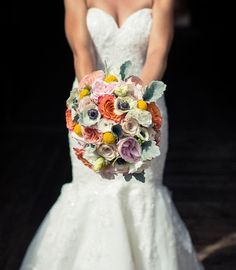 Gorgeous summer wedding bouquet shot in Vail, Colorado.  The bouquet is designed with free spirit roses, white anemones, craspedia, prince jardinière garden roses, quicksand roses and dusty miller accents.  Photo taken by Open Glass Studio.  Flowers designed by www.vailvintagemagnolia.com