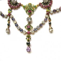 """Close up of an important Renaissance-revival gold and enamel gem-set neckalce by Carlo and Arthur Giuliano, the gold openwork links applied with vivid enamel in tones of yellow and green supporting festoons and fringes of various circular and pear-shaped coloured stones including pink, blue and yellow sapphire, rubies and purple spinel, measuring approximately 15"""" in length, signed C. & A.G, circa 1895-1914"""