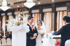Bride smiles at the groom during a wedding ceremony at Dae Dong Manor in Flushing, NY. Captured by NYC wedding photographer Ben Lau.