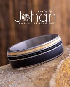 This wedding band for musicians is handmade with vinyl from an LP record, a black guitar string, and aspen wood. #JewelrybyJohan Aspen Wood, Red Palm, Guitar Strings, Rock And Roll, Lp, Wedding Bands, Musicians, Rings For Men, Wedding Inspiration