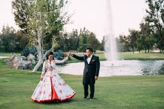 Love this shot in front of the fountain and the contrast of her Indian wedding gown. Studio Merima Photography  shaadishop.co
