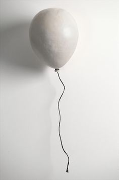 the idea of the ballon is contrast to the material of the sculpture-contradictory