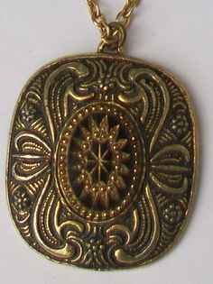 Vintage pendant and chain necklace The pendant is in ornate gold tone with a raised centre decorated with mosaic style black glass inserts Black Glass, Glass Pendants, Pocket Watch, Big Necklaces, Mosaic, Buy And Sell, Chain, Centre, Gold