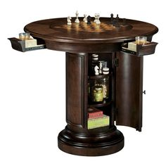 The Howard Miller Ithaca Pub Table is just the thing to turn your bar into an upscale lounge. This round pub table is made of wood with a Hampton Cherry. Round Pub Table, Pub Table Sets, Bar Tables, Outdoor Patio Bar Sets, Chess Table, High Top Tables, Howard Miller, Pub Set, Table Games