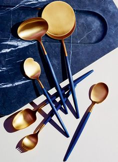 Spoon set by David Collins Studio and Cutipol. Inspired by his personal collection of vintage cutlery, Simon Rawlings, creative director of David Collins Studio, devised this spoon set, appropriate for cheese, oysters, eggs, caviar, sorbet and soup. Using Cutipol's Goa range as a starting point, the handles feature the studio's signature blue shade.