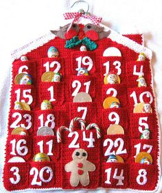 Crochet Advent Calendar by Clare Collier - This pattern is available for £3.00 GBP. A crochet advent calendar with pockets for each day. Works up quickly in double knitting yarn. Templates for the felt robins and gingerbread man are included.