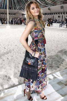 Paris Jackson in a Dior multicolor patchwork dress with long beaded necklaces and a fringe bag