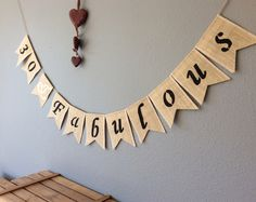 A personal favourite from my Etsy shop https://www.etsy.com/uk/listing/516409567/30th-birthday-bunting-banner-hessian
