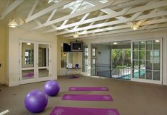 Exercise Room with doors that open to the pool...