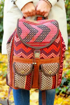 Kandu Double Pocket Kilim Backpack. Handmade from bright, bold kilim rugs and finished with high quality brass hardware. Perfect for college, traveling or weekends on the road for the free spirit.