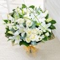 All white superb modern bouquet for Christmas delivery, buy online to send flowers to your loved ones.