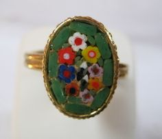Love these vintage Italian mosaic rings. I've worn them for years and would like another. Maybe this lovely mint-green number pour moi.