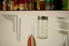 Organize spices with magnets under cabinets/shelves.  What a great idea for organization, not just for spices!