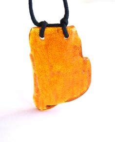 Raw unique Baltic amber pendant