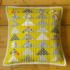 flying geese quilted cushion in yellows and greys