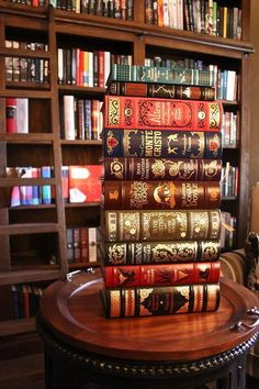 Oh my goodness! I see Sherlock Holmes and also the exact version of Alice in Wonderland that I own! I want all of these beautiful books.