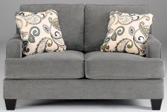 With the rich artistic beauty of the sleek set-back arms and the deep finished tapered block feet the Metro Modern design of the Yvette Steel Loveseat from Ashley uses soft upholstery fabric and plush cushioning to create an exceptional addition to any living room decor.