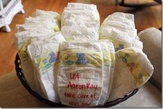 Have guests write an encouraging/funny message on a diaper at baby shower for mom to read when she changes the little one. This is a great idea!!