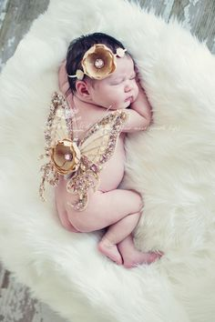 Love the idea of fairy baby pictures <3 but dislike the big ass flower on the wings