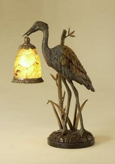 Brass crane lamp with waxstone base, penshell accents, and a verdigris patina finish. #tablelamp #accentlighting #lighting