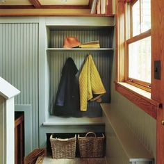 """This open, 18-inch-deep """"closet"""" is carved out of the stair wall leading to the kitchen/living space. The bottom shelf, which overhangs the built-in by 2 inches, doubles as a seat and pit stop for grocery bags. The upper shelf stows hats, plus items the homeowners wish to keep out of reach of their small children."""