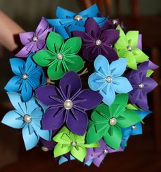 folded paper flowers! Must figure this one out!  DIY. Would be perfect for the throw boquet since paper travels so far!