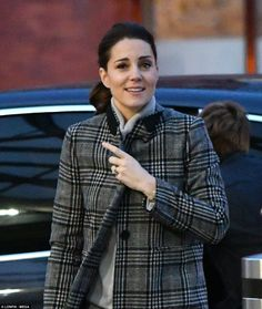 The Duchess of Cambridge made a low-key appearance at Kings Cross St Pancras on Friday morning, the same day that Prince Harry and Meghan Markle attended their first engagement as a couple