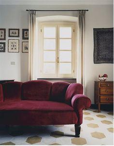 cranberry sofa and hexagonal tiled floor