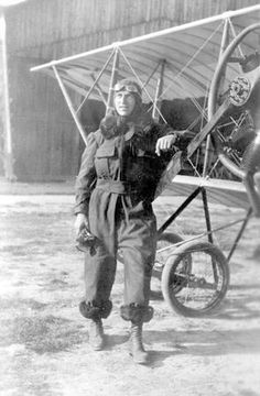 Pilot Eddie Rickenbacker from Columbus, Ohio standing next to a plane he flew during World War I in France, ca. 1914-1918.