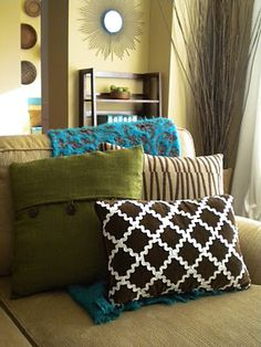 I love this creative application of ric rac.  Dress up a dull pillow with a contrasting color to create a great look!  Check out my website for a variety of colors and sizes of ric rac.  www.allstitchedupbyangela.com