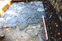 #flagstone This is a flagstone patio being laid over a concrete base.