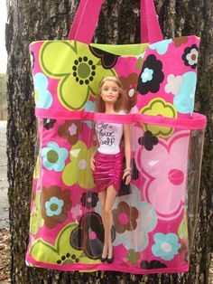 This listing is for 1 barbie tote bag. This bag is approximately 13x14. It has clear vinyl pockets all the way around the bag for your barbies to fit