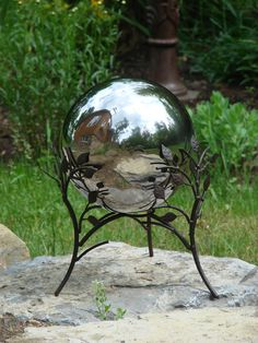 Gazing balls make lovely focal points for many gardens and yards, and they offer a fascinating display of light refraction throughout the day.  $45 Available at www.mondusdistinction.com