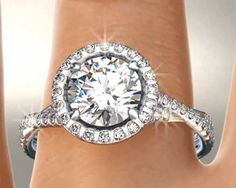 Sparkly Twisted Band Diamond Halo Engagement Ring by James Allen | bridesandrings.com