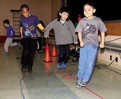 Jen Marra / First-graders Demetrius Boyer, Matt Murray and Leonardo Ortiz Cortez find a creative way to jump rope.