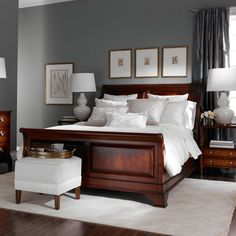 """Life is but a dream. Be lulled to sleep in this romantic Belle Époque sleigh bed. The carved molding wraps completely around the headboard, rails, and footboard, providing the option of floating the bed away from a wall. Brass-plated rosettes in scroll of headboard and footboard Raised panels and molding details on headboard and footboard Footboard height 28.5"""" Headboard height 53.25"""" Finish: Belmont (570)"""