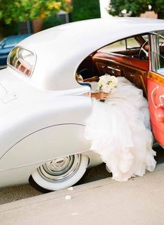vintage car and pretty dress, I actually just like how you can't yet see the bride's face :)