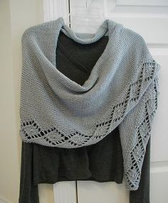 "Acadian can be worn as a shawl or a scarf. It is knitted tip to tip. The model is knit in worsted weight, but you can use any weight yarn you like, though you may need to knit more or less repeats to get the desired length and your yardage requirements will vary. The model is 76"" long by 18"" deep. Longer is better with this shawl!"