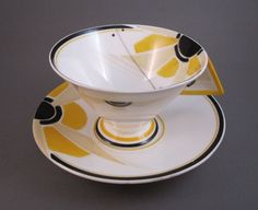 """Vogue"" shaped porcelain teacup in the bright yellow Sunray pattern 11742, designed by Eric Slater for Shelley and introduced in August 1930. Discontinued in 1933, due to impractically designed hard to hold cup handle.    http://abaseman.tempwebpage.com/blog/"